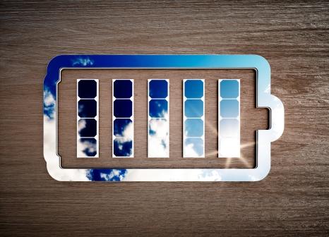 Renewable energy storage sign on dark wooden desk.